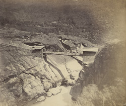 View of a footbridge in the Himalayas. [Over the Sutlej?]